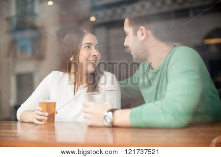 Cute Girl Flirting With A Guy At The Bar