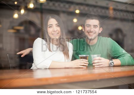 Good Looking Couple Drinking Beer At A Bar