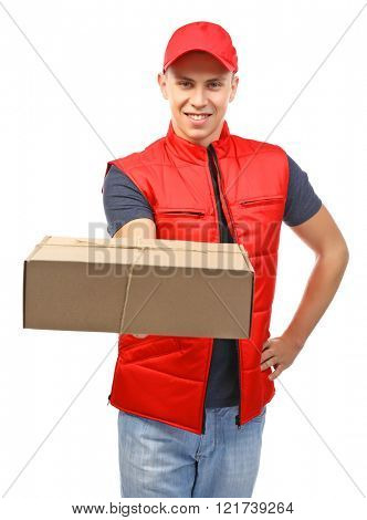 Young handsome delivery man with a carton package, isolated on white
