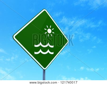 Vacation concept: Beach on road sign background