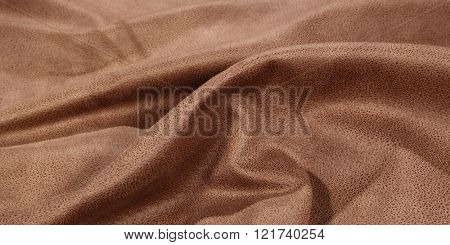 Brown wrinkly textile material woven cloth