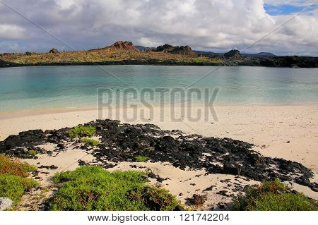 Santiago Island Seen From The Beach Of  Chinese Hat Island, Galapagos National Park, Ecuador.