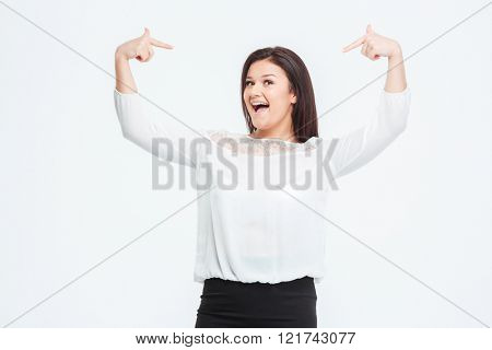 Cheerful businesswoman pointing finger at herself isolated on a white background