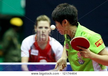 KUALA LUMPUR, MALAYSIA - SEPTEMBER 24: Guo Yue of China serves against Natalia Partyka of Poland at the Volkswagen 2010 Women's World Cup in table tennis on September 24, 2010 in Kuala Lumpur.