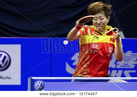 KUALA LUMPUR, MALAYSIA - SEPTEMBER 24: Guo Yan, China (ITTF World Ranking #3) smashes the ball during the Volkswagen 2010 Women's World Cup in table tennis on September 24, 2010 in Kuala Lumpur.