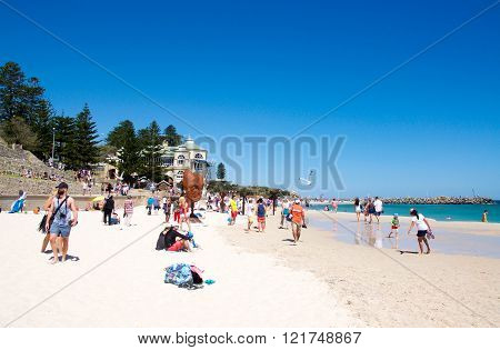 COTTESLOE,WA,AUSTRALIA-MARCH 12,2016:  Crowds viewing the sculptures at the interactive free public arts festival