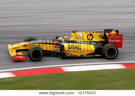 KUALA LUMPUR - APRIL 4: Renault F1 driver Robert Kubica powers down the track on race day at the 2010 Petronas Malaysia Grand-Prix on April 4, 2010 in Sepang International Circuit, Malaysia.