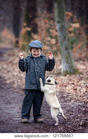 Cute Little Child, Playing With Little Pet Dog In The Forest