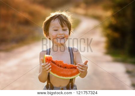 Beautiful Happy Child, Boy, Eating Big Slice Of Watermelon