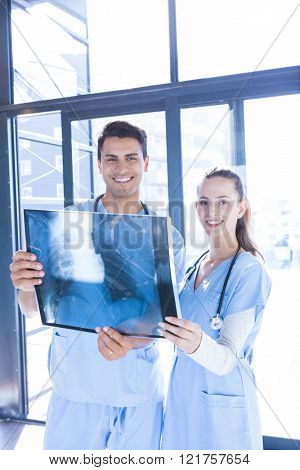 Portrait of medical team examining x-ray at the hospital