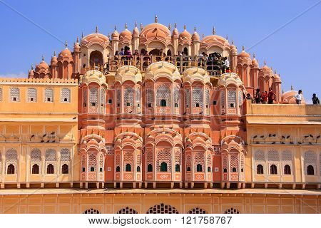 JAIPUR, INDIA - FEBRUARY 27: Unidentified people visit Hawa Mahal on February 27, 2011  in Jaipur, India. Hawa Mahal was designed by Lal Chand Ustad in the form of the crown of Krishna, the Hindu god.