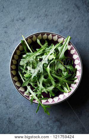 Fresh arugula in a bowl