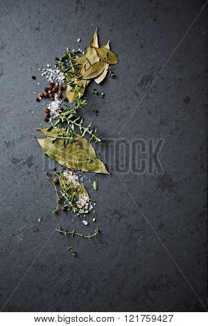 Herbs and spices on a stone background