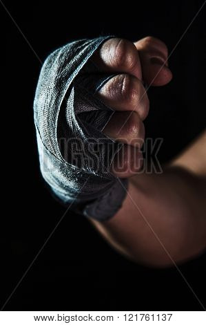 Close-up hand of muscular man with bandage