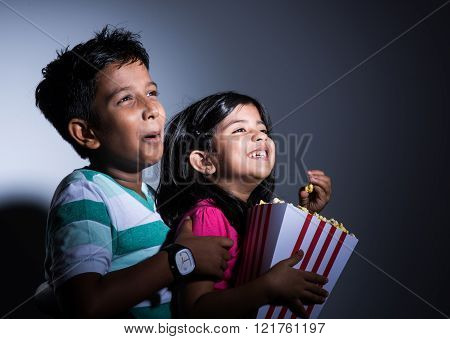indian cute girl and boy eating popcorn, asian kids and popcorn