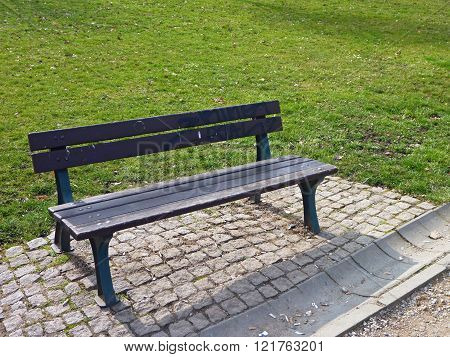 Lonely Bench In A Green Park