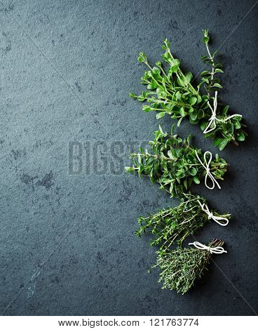 Assorted herbs on a stone background