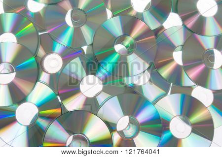 Given A Set Of Dvds Scattered On A Table White Colored Background