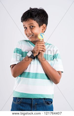 indian small boy with lolipop or loly pop, asian boy and lolipop or lolypop, playful indian boy posi
