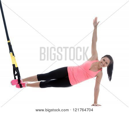 Athletic woman with functional loops for training isolated on white background.