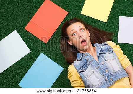 Woman in panic surrounded with empty papers