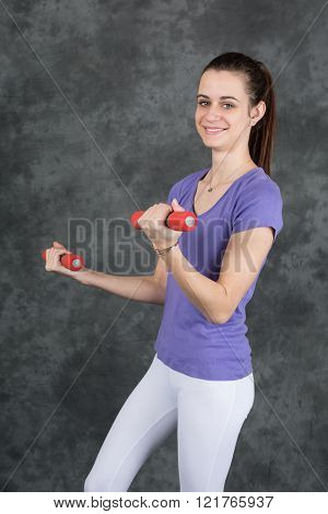 Happy Fitness Woman Lifting Dumbbells Smiling Cheerful, Fresh And Energetic. Mixed Race Asian Caucas