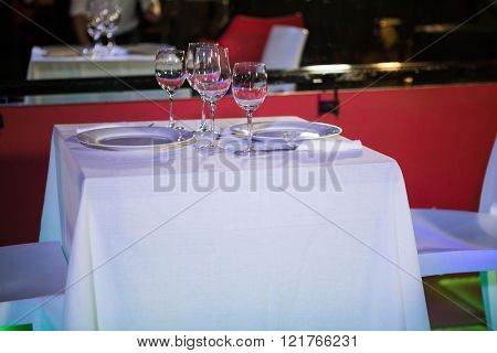 Table laid for two in bar