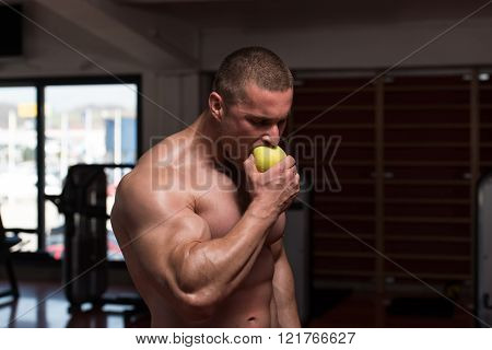 Bodybuilder Man Eating An Apple