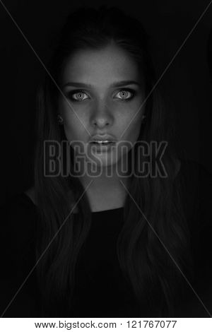 Vogue style photo of sensual womanwith blue eyes and freackles black and white