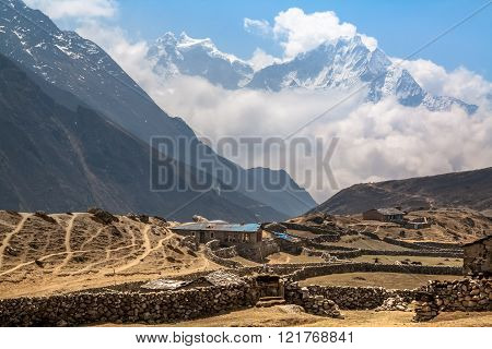 Mountain Village Under The Snow-capped Peaks In Gokio Valley. Himalayas.