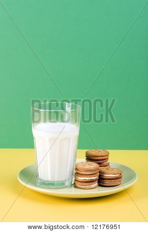 Plate of milk cream filled shortcake and a glass of milk isolated on plate