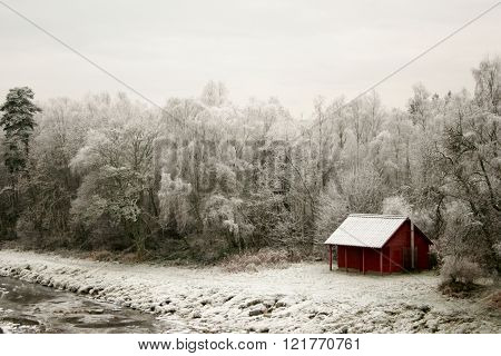Fishing hut by river in winter in scotland