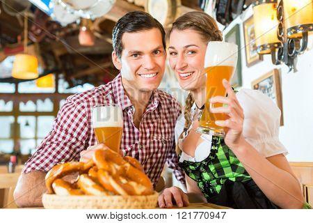 Couple drinking wheat beer in bavarian restaurant