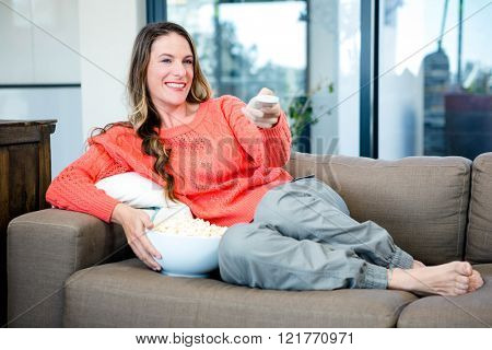 woman lying on the couch in the sitting room with popcorn