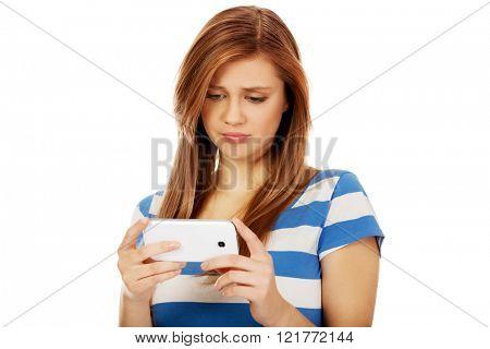 Teenage woman using her smartphone