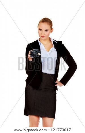 Business woman pointing on camera with umbrella
