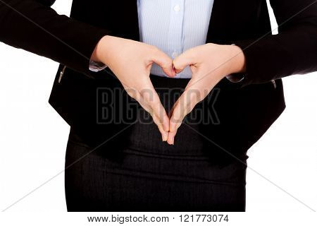 Business woman making a heart shape with her hands