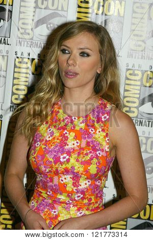 Scarlett Johansson arrives at the 2013 Comic Con press room for Marvel's
