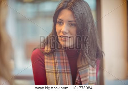 Portrait of woman talking in cafe