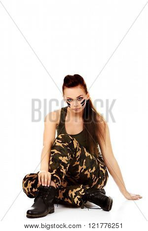 Ypung beautiful soldier woman sitting on the floor