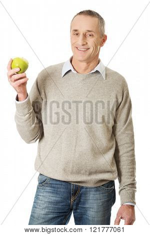 Mature man with an apple