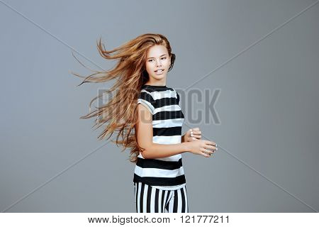 Portrait of a pretty teenager girl. Modern style, youth fashion. Studio shot.