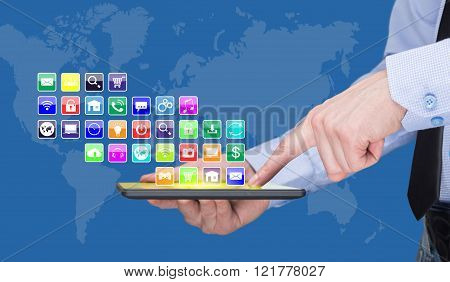 Businessman holding a tablet pc with mobile applications icons on virtual screen . Internet and busi