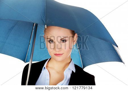 Blonde business woman holding an umbrella