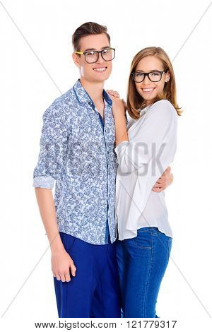 Happy young people in glasses looking at camera and laughing. Isolated over white.