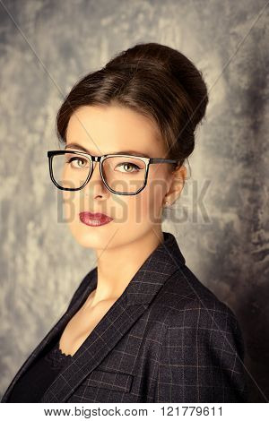 Portrait of a beautiful business lady in spectacles.