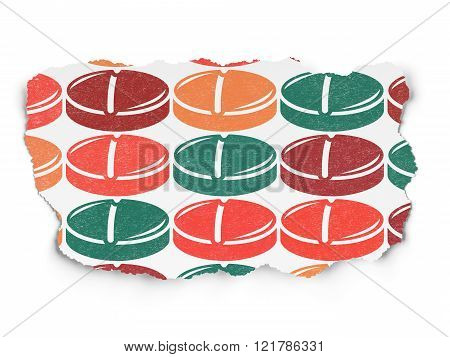 Health concept: Pill icons on Torn Paper background