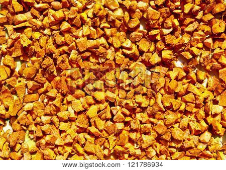 finely chopped turmeric squares kept under sunlight for drying and later to be powdered