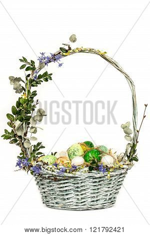 Easter Holiday Krashanye Eggs In A Basket With Flowers On A White Background . Food.