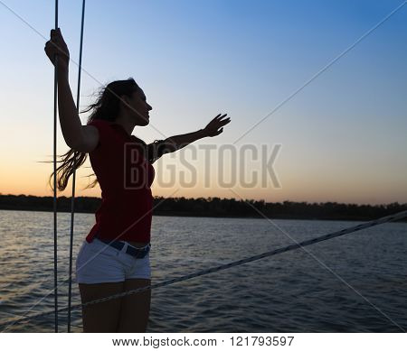 Beautiful Woman On Yacht Deck In Sunset Light
